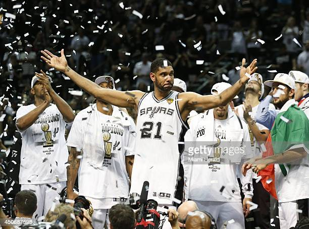 The San Antonio Spurs celebrate with the NBA Championship Larry O'Brien trophy after defeating the Miami Heat 10487 in Game 5 of the NBA Finals at...