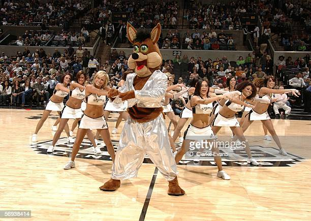 The San Antonio Spurs Coyote and Silver Dancers entertain the crowd as the San Antonio Spurs host the Golden State Warriors during the game at the...