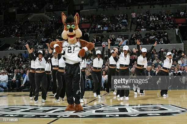 The San Antonio Spurs Coyote and Silver Dancers entertain the crowd as the Spurs host the Golden State Warriors at the ATT Center December 4 2006 in...