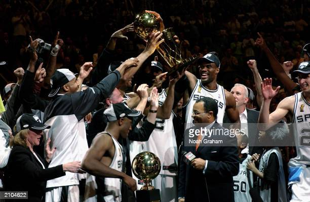 The San Antonio Spurs hold the 2003 NBA Finals Champtionshiop Trophy after defeating the New Jersey Nets in Game six of the 2003 NBA Finals at SBC...