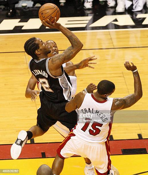 The San Antonio Spurs' Kawhi Leonard scores in the lane against the Miami Heat in the first quarter during Game 4 of the NBA Finals at American...