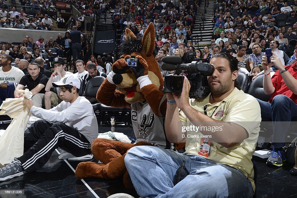 The San Antonio Spurs mascot, Coyote, takes some pictures during the game against the Atlanta Hawks on April 6, 2013 at the AT&T Center in San Antonio, Texas.