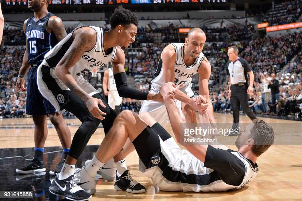 The San Antonio Spurs show a display of great teamwork during the game against the Orlando Magic on March 13 2018 at the ATT Center in San Antonio...
