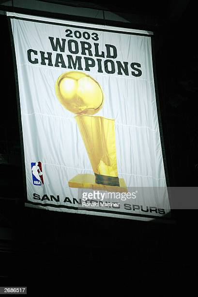 The San Antonio Spurs World Championship banner is hung before the game between the Spurs and the Phoenix Suns on October 28 2003 at the SBC Center...