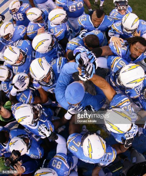 The San Diego Chargers huddle before entering the game against the Indianapolis Colts during the Chargers 2317 sudden death overtime win in the NFL...