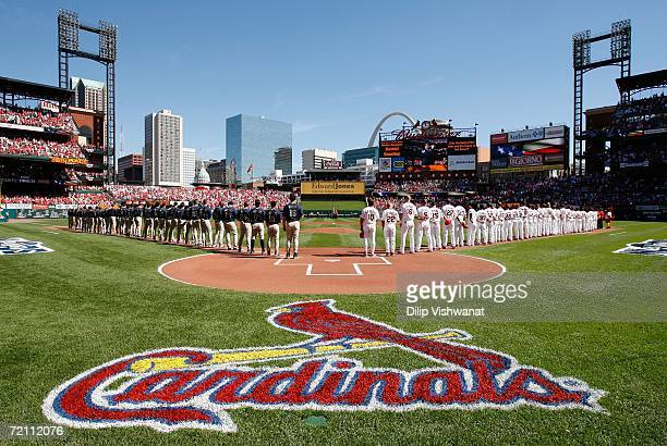 The San Diego Padres and the St Louis Cardinals line up during the National Anthem for Game Three of the National League Division Series at Busch...