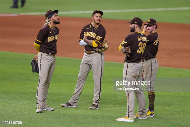 The San Diego Padres infield meet during a mound visit at the MLB game between the San Diego Padres and Texas Rangers on August 17, 2020 at Globe...