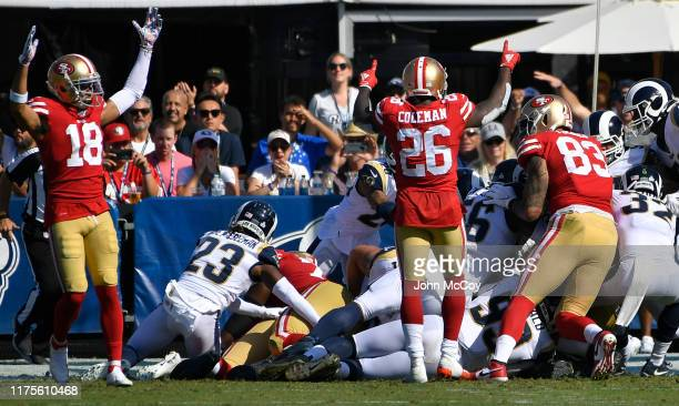 The San Francisco 49ers celebrate a touchdown at the start of the third quarter against the Los Angeles Rams at Los Angeles Memorial Coliseum on...
