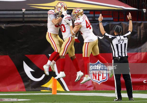 The San Francisco 49ers celebrate a touchdown scored by running back Jeff Wilson Jr. #30 during the first half against the Arizona Cardinals at State...