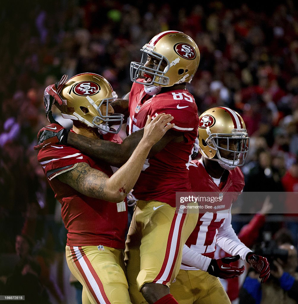 The San Francisco 49ers' Colin Kaepernick and Vernon Davis celebrate after Kaepernick's 21-yard touchdown scoring run in the first quarter against the Green Bay Packers in the NFC Divisional Playoff on Saturday, January 12, 2013, at Candlestick Park in San Francisco, California.