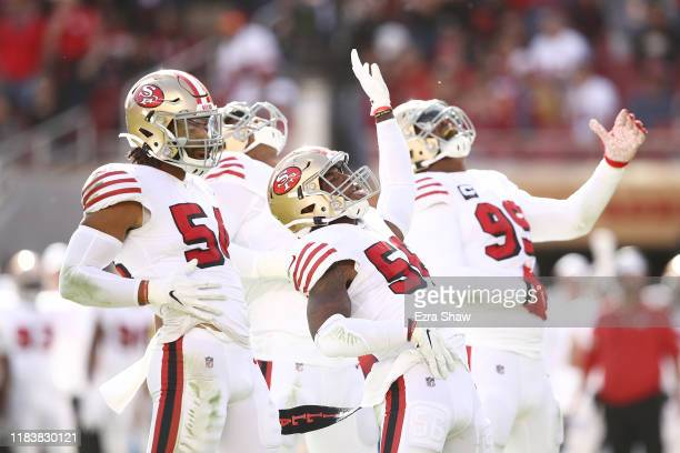 The San Francisco 49ers defense celebrates after a sack against the Carolina Panthers during the second quarter at Levi's Stadium on October 27 2019...