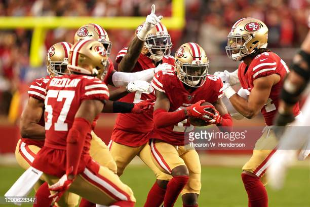 The San Francisco 49ers defense celebrates after an interception by Emmanuel Moseley in the first half against the Green Bay Packers during the NFC...
