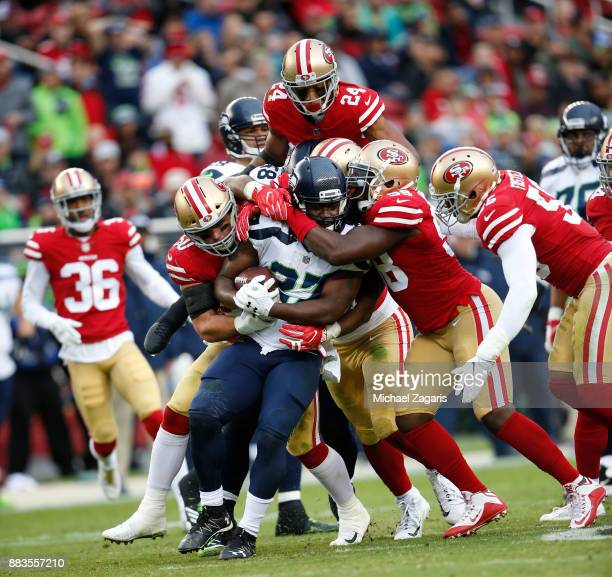The San Francisco 49ers defense teams up to stop Eddie Lacy of the Seattle Seahawks during the game at Levi's Stadium on November 26 2017 in Santa...