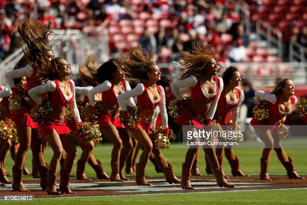 The San Francisco 49ers Gold Rush cheerleaders perform during their NFL game against the Arizona Cardinals at Levi's Stadium on November 5 2017 in...