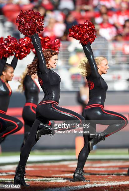 The San Francisco 49ers Gold Rush dancers performs during an NFL football game against the Arizona Cardinals at Levi's Stadium on November 29 2015 in...
