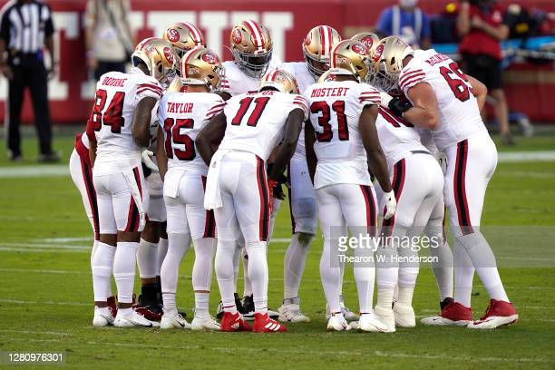 The San Francisco 49ers huddle against the Los Angeles Rams during the first quarter at Levi's Stadium on October 18, 2020 in Santa Clara, California.