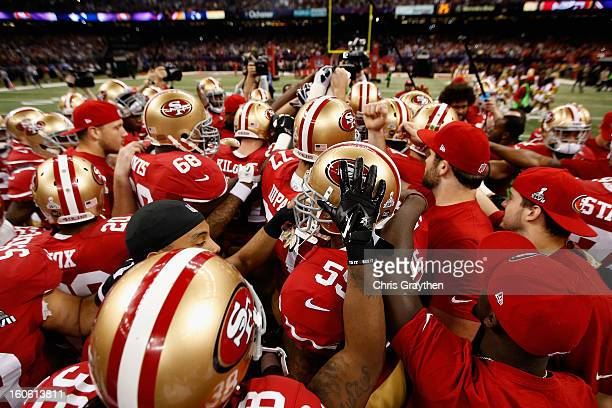 The San Francisco 49ers huddle up prior to the start of Super Bowl XLVII against the Baltimore Ravens at the MercedesBenz Superdome on February 3...