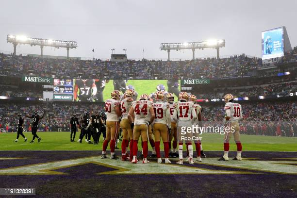 The San Francisco 49ers offense huddles against the Baltimore Ravens at MT Bank Stadium on December 01 2019 in Baltimore Maryland