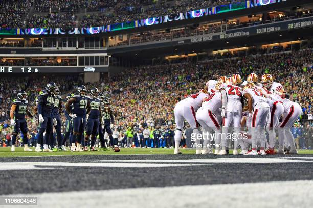 The San Francisco 49ers offense huddles while the Seattle Seahawks defense waits during the second quarter of the game at CenturyLink Field on...