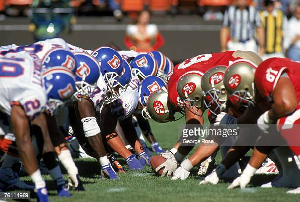 The San Francisco 49ers offensive line and the Denver Broncos defensive line square off at the line of scrimmage during a preseason game at...
