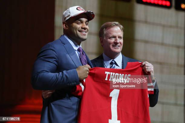 The San Francisco 49ers select Solomon Thomas of Stanford with the third pick at the 2017 NFL Draft and poses the NFL Commissioner Roger Goodell at...