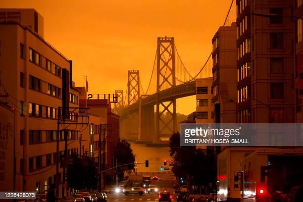 The San Francisco Bay Bridge is seen along Harrison Street under an orange smoke-filled sky in San Francisco, California on September 9, 2020. - More...