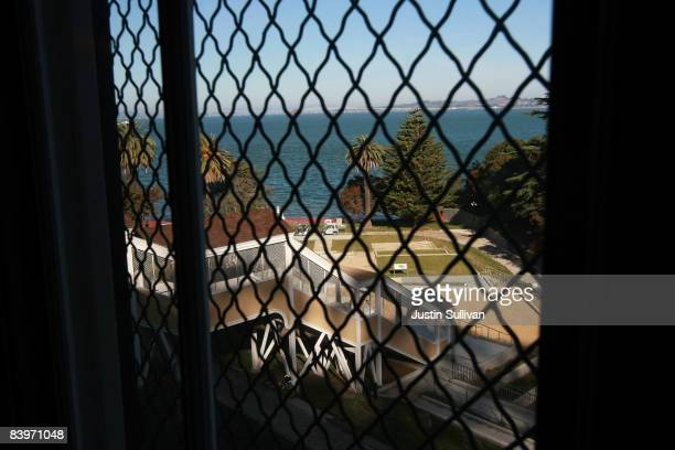 The San Francisco Bay is seen through a window in the detention barracks at the Angel Island Immigration Station December 9 2008 on Angel Island in...