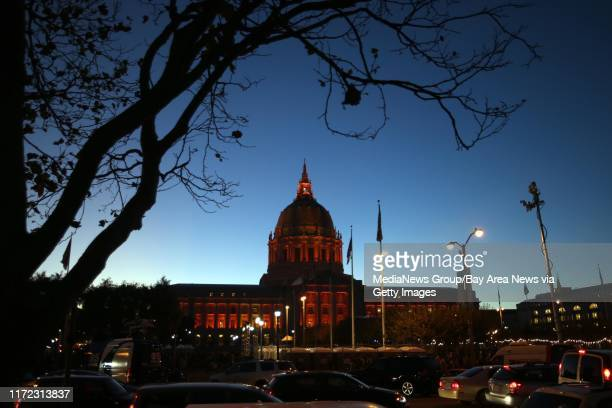 The San Francisco City Hall is illuminated in orange as Giants fans watch game 7 of the World Series Championship against the Kansas City Royals seen...