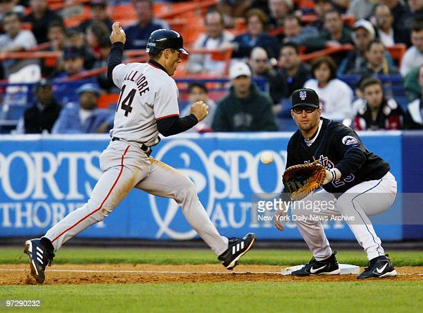The San Francisco Giants' Brian Dallimore hustles back to first as Jason Phillips awaits the throw in a pickoff try in the first at Shea Stadium. The...