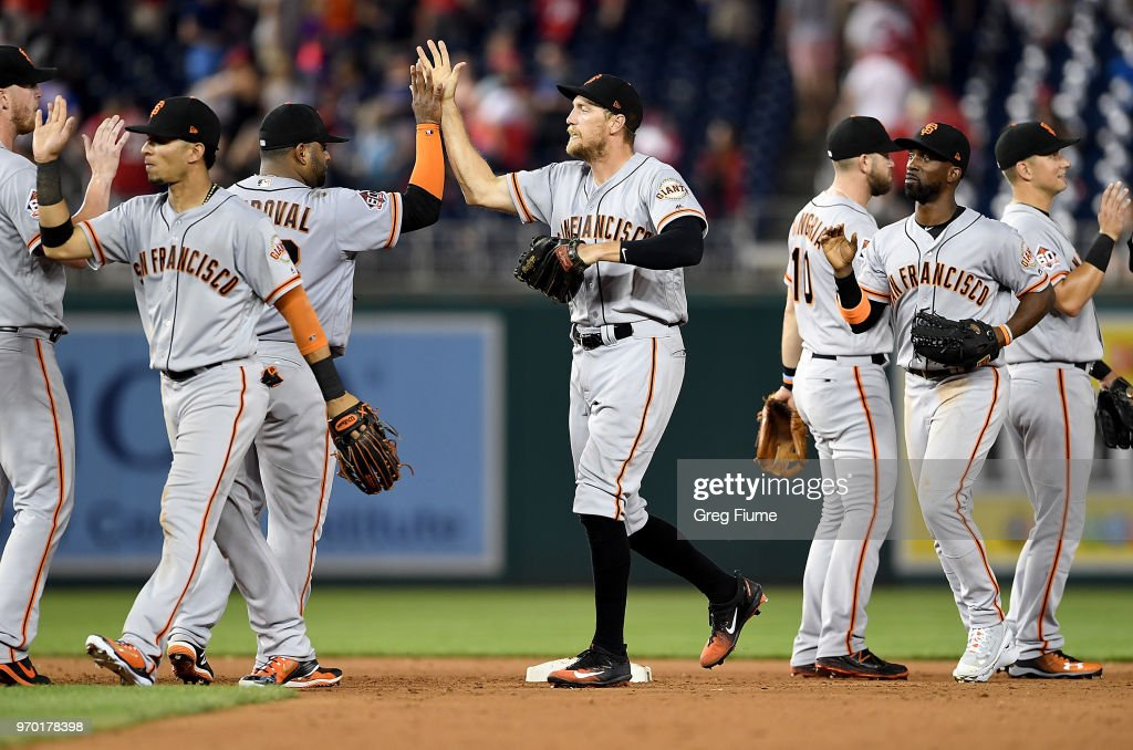 The San Francisco Giants celebrate after a 9-5 victory against the Washington Nationals at Nationals Park on June 8, 2018 in Washington, DC.