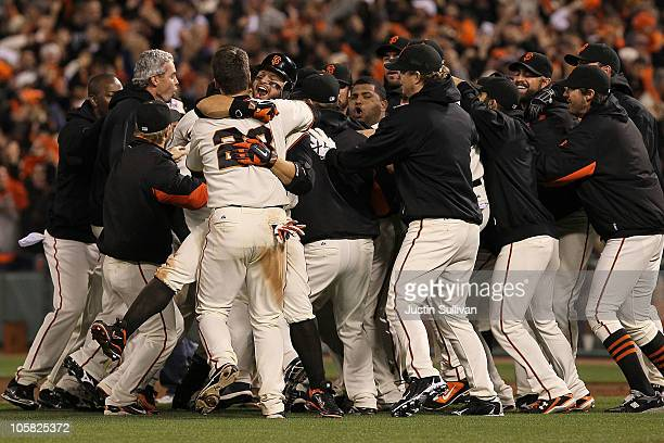 The San Francisco Giants celebrate after a sacrifice fly by Juan Uribe scored Aubrey Huff to win the game 6-5 over the Philadelphia Phillies in Game...