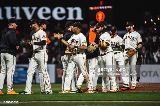 The San Francisco Giants celebrate after defeating the San Diego Padres and clinching a 2021 playoff berth at Oracle Park on September 13, 2021 in...