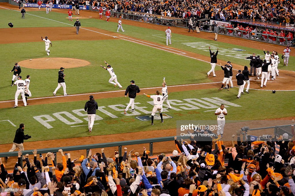 The San Francisco Giants celebrate after defeating the St. Louis Cardinals 6-3 during Game Five of the National League Championship Series at AT&T Park on October 16, 2014 in San Francisco, California.