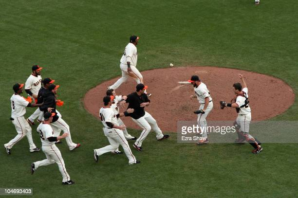 The San Francisco Giants celebrate after they beat the San Diego Padres to win the National League West Title at ATT Park on October 3 2010 in San...