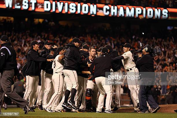 The San Francisco Giants celebrate after they beat the San Diego Padres to clinch the National League West Division Title at ATT Park on September 22...