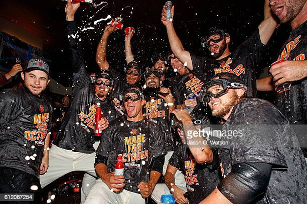 The San Francisco Giants celebrate in the clubhouse after the game against the Los Angeles Dodgers at ATT Park on October 2 2016 in San Francisco...