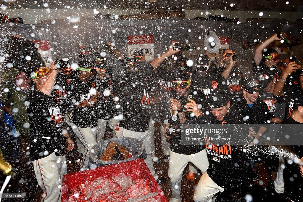 The San Francisco Giants celebrate in the locker room after defeating the St. Louis Cardinals 6-3 during Game Five of the National League Championship Series at AT&T Park on October 16, 2014 in San Francisco, California.