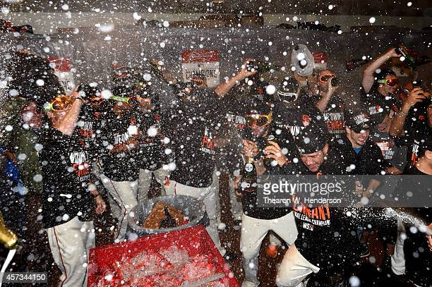 The San Francisco Giants celebrate in the locker room after defeating the St Louis Cardinals 63 during Game Five of the National League Championship...