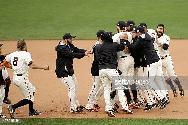The San Francisco Giants celebrate the 54 10th inning victory against the St Louis Cardinals during Game Three of the National League Championship...