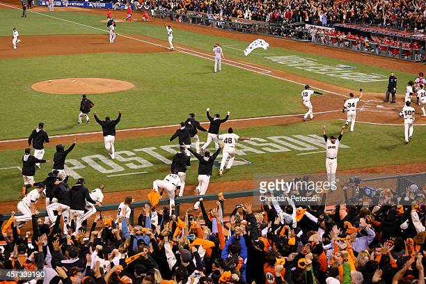 The San Francisco Giants celebrate the threerun walkoff home run by Travis Ishikawa as they defeat the St Louis Cardinals 63 during Game Five of the...