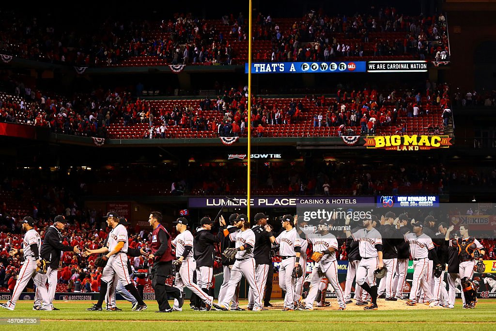 The San Francisco Giants celebrate their 3 to 0 win over the St. Louis Cardinals in Game One of the National League Championship Series at Busch Stadium on October 11, 2014 in St Louis, Missouri.