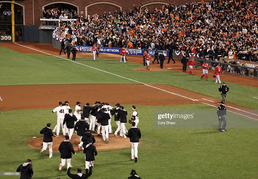 The San Francisco Giants celebrate their 3 to 2 win over the Washington Nationals in Game Four of the National League Division Series at AT&T Park on October 7, 2014 in San Francisco, California.