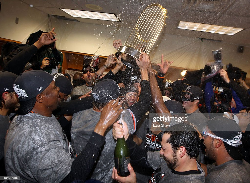 The San Francisco Giants celebrates the Commissioner's Trophy in the locker room after defeating the Detroit Tigers to win Game Four of the Major League Baseball World Series at Comerica Park on October 28, 2012 in Detroit, Michigan. The San Francisco Giants defeated the Detroit Tigers 4-3 in the tenth inning to win the World Series in 4 straight games.