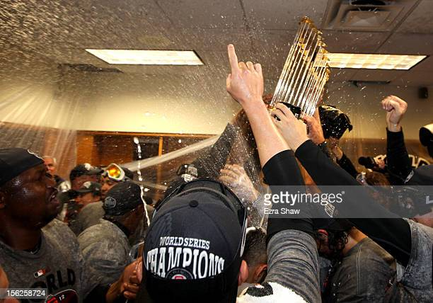 The San Francisco Giants celebrates the Commissioner's Trophy in the locker room after defeating the Detroit Tigers to win Game Four of the Major...