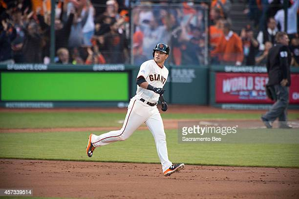The San Francisco Giants' Joe Panik watches his tworun home run in the third inning against the St Louis Cardinals in Game 5 of the National League...
