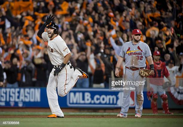 The San Francisco Giants' Michael Morse celebrates his home run to left field in the eighth inning against the St Louis Cardinals in Game 5 of the...