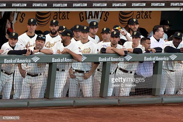 The San Francisco Giants stand in the dugout during the 2014 World Series ring ceremony before the game against the Arizona Diamondbacks at ATT Park...
