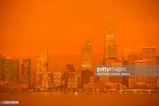 The San Francisco skyline is obscured in orange smoke and haze as their seen from Treasure Island in San Francisco, California on September 9, 2020....