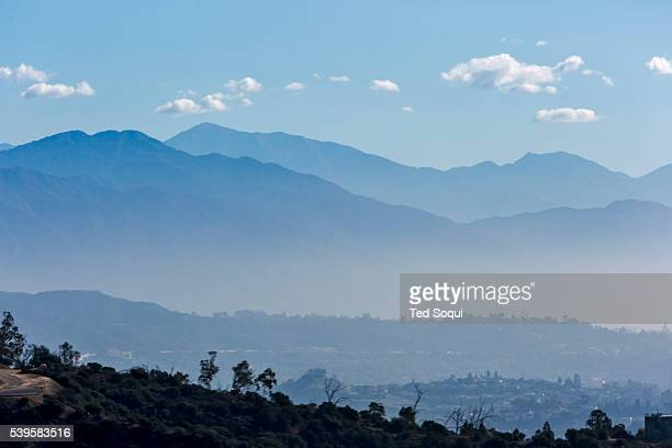 The San Gabriel mountains above Los Angeles with an inversion layer of dirty air smog SB 350 signed in to law California Governor Jerry Brown signing...