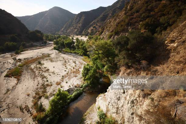 The San Gabriel River is seen on June 29, 2021 in the San Gabriel Mountains near Azusa, California. The San Gabriel Reservoir is almost completely...